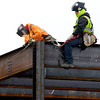 THB photo/John P. Cleary<br /> These iron workers are dressed for the cold as they work on top of the steel structure that will become the new St. Vincent Anderson Regional Hospital's Surgery Pavilion.  Construction continues with completion targeted for late 2014.