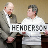 Don Knight / The Herald Bulletin<br /> Pendleton Town Council member Jeanette Isbell presents Don Henderson with a street sign as the council honored Henderson for his 13 years of service by renaming Settlement Way Henderson Way during Henderson's last meeting before retiring from the council on Thursday.