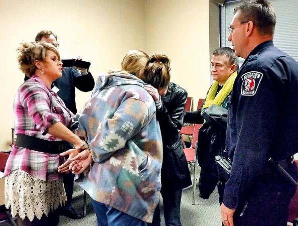 Jack Molitor | The Herald Bulletin<br /> Joetta Sells arrested after court hearing.