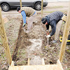 Don Knight | The Herald Bulletin<br /> From left, Brandon Sheets and Josh Wallace excavate to make room for the frame of a wheel chair ramp at a home in Yorktown on Thursday.