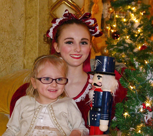 Mark Maynard | For The Herald Bulletin<br /> Young fan Clair Miller poses for a picture with Lauren Owen who danced the part of Claire in the Friday evening performance of the Nutcracker Ballet at the Paramount Theatre.
