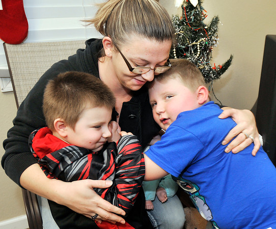 John P. Cleary    The Herald Bulletin<br /> Kelly Brown, and her two sons Braxton,3, and Trenton, 5, are staying in the Fire Rescue House for part of the holiday after experiencing a fire.