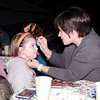 "Mark Maynard | For The Herald Bulletin<br /> Ashley Smalley puts the finishing touches on Destiny Amos's face painting during East Side Church of God's ""Imagine Christmas"" celebration, which continues Saturday night from 6:00-8:00 p.m."