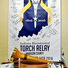 John P. Cleary |  The Herald Bulletin<br /> Part of the Anderson/Madison County Visitors Bureau Torch Relay exhibit consists of one of the torches used in the relay through the county and a large banner signed by all the torchbearers that took part.