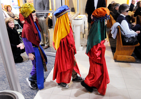 Don Knight | The Herald Bulletin<br /> Dressed as three wise men, from left, Conner Kettery, Garrett Blanton and Laureano Duffy enter the sanctuary during Christmas Eve mass at St. Mary's in Alexandria on Saturday.