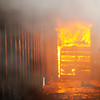 Don Knight | The Herald Bulletin<br /> Pallets burn in a room at the end of a hallway built in a converted shipping container at the Region 6 Fire Training Facility in Anderson.  AFD received a $75,000 grant for their training facility. Anderson received a $75,000 grant from the Indiana Department of Homeland Security for upkeep, maintenance and making improvements to the training facility.