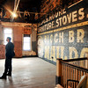 John P. Cleary | The Herald Bulletin<br /> The A Town Center being developed downtown Anderson by Levi Rinker and Sonia Caldwell. Stripping down the walls of the second floor uncovered this old sign painted on the old brick walls that they refurbished.