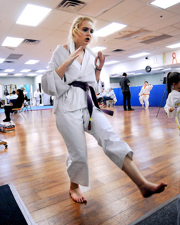 John P. Cleary |  The Herald Bulletin<br /> Hailey Greer, 15, kicks as many times she can in one hour at the T.A.S.K. Karate Studio Friday during a fundrasing kick-a-thon.