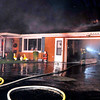John P. Cleary |  The Herald Bulletin<br /> House fire at the corner of Iroquois Street and North Scatterfield Road.