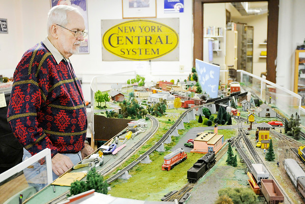 Don Knight | The Herald Bulletin<br /> Roger Hensley operates an HO scale model railroad at the Madison County Historical Society on Saturday. The train exhibit will be open again this Saturday as part of their holiday hours.