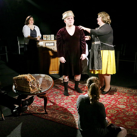 Mark Maynard | for The Herald Bulletin<br /> George (Cameron Vale) models his mother Delores's (Gretchen Stapleton) dress so she can check Raisa's (Kathleen Wile) needlework as his sister Gloria (Julia Beeler) looks on with amusement.