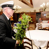 Don Knight | The Herald Bulletin<br /> Navy veteran Don Platt carries a wreath for the Navy during the Wreaths Across America remembrance service for veterans held at the Loose Funeral Home on Saturday.