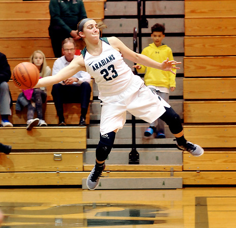 Pendleton's Sam Hammel leaps high out of bounds to save a loose ball.