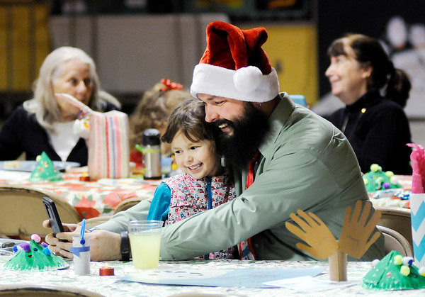 Don Knight   The Herald Bulletin<br /> Bryan Flanigan and his daughter Nadia, 6, pose for a selfie during candlelight lunch for children and parents at Edgewood Elementary on Tuesday. The lunch is a holiday tradition at the school.