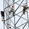 Don Knight | The Herald Bulletin<br /> A crew works on the new communications tower at the county's new consolidated dispatch center and EMA on Wednesday. The new radio system went live this week.