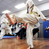 John P. Cleary |  The Herald Bulletin<br /> Aaliyah Fairchild, 7, kicks high as she takes part in the T.A.S.K. Karate Studio kick-a-thon fundraiser Friday. Participants kick as many times as they can in one hour for pledges.