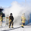 Don Knight | The Herald Bulletin<br /> From left, Shawn Williams, Bob Bennett, health and safety chief Mark Keck and A shift Battalion Chief Ken Helpling exit a shipping container modified to simulate a hallway with bedrooms during training at the Region 6 Fire Training Facility in Anderson on Tuesday.