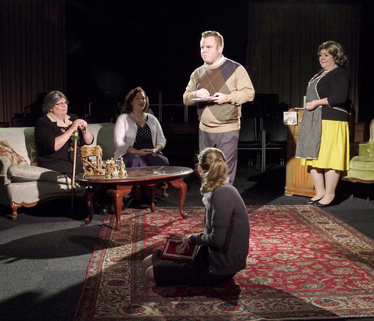 """Mark Maynard   for The Herald Bulletin<br /> Edna (Judy Pochard), Raisa Chernenko (Kathleen Wile), Delores (Gretchen Stapleton) and Gloria (Julia Beeler) look on as George (Cameron Vale) feels the effects of Raisa's vodka-laced fruit cake in the Alley Theatre's production of Rick Vale's """"Snowman."""""""