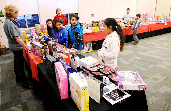Don Knight | The Herald Bulletin<br /> Children pick a gift during the Madison County Community Health Center's annual toy give away on Wednesday. The center had gifts for children 0 to 12 years old.