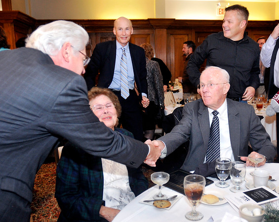 John P. Cleary |  The Herald Bulletin<br /> Anderson Mayor Thomas Broderick congratulates Shirley and Ken Montgomery, of krM Architecture+, as being named the 2016 Madison County Chamber Entrepreneur Award winner at the annual award luncheon Friday.