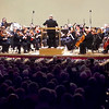 "Mark Maynard | For The Herald Bulletin<br /> Flanked by Christmas lights, the Anderson Symphony Orchestra, under the baton of Maestro Rick Sowers, entertained a festive crowd with holiday tunes during its annual ""A Symphony Christmas"" at the Paramount Theatre."