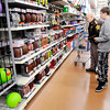 Don Knight | The Herald Bulletin<br /> Madison County deputy Brad Oster helps Christopher Moore pick out a football while shopping during APD's Cops & Kids program at Walmart on Wednesday. This was the 27th year for the program.