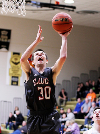 Chris Martin | For The Herald Bulletin<br /> Elwood's Caleb Jones puts up a rebound Friday night at Madison-Grant.