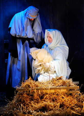 Don Knight | The Herald Bulletin<br /> Mary and Joseph, portrayed by Derek and Amanda Windle, look down at baby Jesus during Maple Grove Church of God's Live Outdoor Nativity Pageant on Saturday. This is the 41st Anniversary of the pageant which was started by Layman Life Insurance in 1975 and given to the church in 1978. The soundtrack for the pageant was narrated by Dale Oldham. The pageant will perform again Sunday at 6, 6:30 and 7 p.m. Coffee, Hot Chocolate and Christmas cookies are served after each performance.