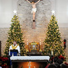 Don Knight | The Herald Bulletin<br /> Father Dan Duff leads a Christmas Eve mass at St. Mary's in Alexandria on Saturday afternoon.