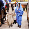 Don Knight | The Herald Bulletin<br /> Dressed as Joseph and Mary Zerek Granger and Ella Rogers walk out of the sanctuary followed by Bryden Petty dressed as a shepherd during Christmas Eve mass at St. Mary's in Alexandria on Saturday.
