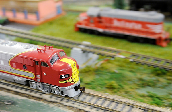 Don Knight | The Herald Bulletin<br /> An HO scale Santa Fe locomotive runs around a display at the Madison County Historical Society on Saturday. The model train display is open in the basement of the Historical Society.