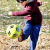 John P. Cleary |  The Herald Bulletin<br /> Daniel Rubio, 6, works on his soccer kicks as he plays with family and friends during an outing at the Shadyside Park Alex Pike playground Tuesday afternoon.