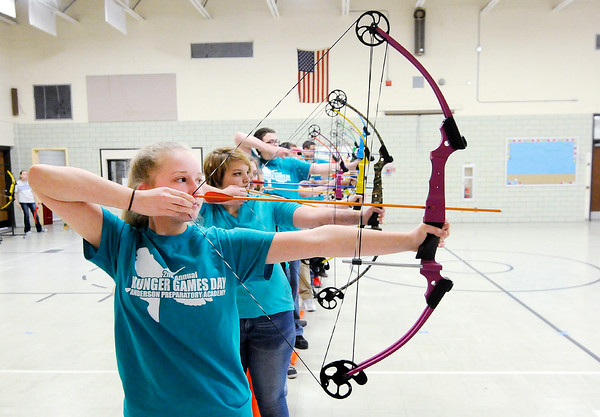Don Knight   The Herald Bulletin<br /> Riley Scott takes aim during archery instruction during Hunger Games Day at APA on Wednesday.