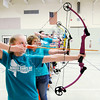 Don Knight | The Herald Bulletin<br /> Riley Scott takes aim during archery instruction during Hunger Games Day at APA on Wednesday.