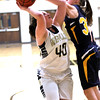Photo by Chris Martin. Shenandoah's Hillery Shepherd blocks Madison-Grant's McKenna Luger Tuesday night at Madison-Grant.  The Lady Argyll's defeated the Lady Arabians