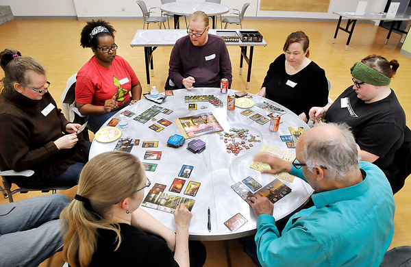 John P. Cleary |  The Herald Bulletin<br /> These folks are enjoying playing 7 WONDERS tabletop game during the monthly Game Night for Grownups at Anderson Public Library. Each month on the second Monday APL has a gaming group for adults to play a different tabletop game each month.  The library as started to offer these games for checkout for up to 14 days.<br /> <br /> <br /> Game Night for Grownups at Anderson Public Library.