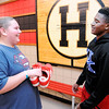 Don Knight | The Herald Bulletin<br /> When Highland student R.J. Nunn, right, heard his classmate J.T. Timmons needed shoes he gave him two pairs of his own shoes.