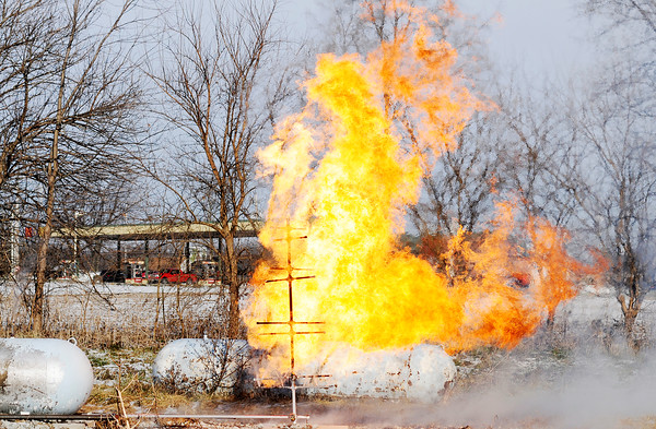 Don Knight   The Herald Bulletin<br /> Propane burns from a series of pipes designed to simulate a gas line fire at the Region 6 Fire Training Facility in Anderson. Anderson received a $75,000 grant from the Indiana Department of Homeland Security for upkeep, maintenance and making improvements to the training facility.