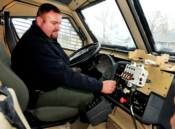 John P. Cleary    The Herald Bulletin<br /> Pendleton Police Department chief Marc Farrer checks the controls for the  Mine-Resistant Ambush Protected vehicle from Afghanistan that the department has received.