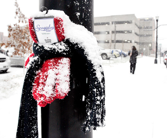 John P. Cleary    The Herald Bulletin<br /> Hats, scarves and mittens were seen posted along Meridian Street through downtown Wednesday. Some had notes attached encouraging those in need to take them.
