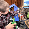 John P. Cleary |  The Herald Bulletin<br /> Jeffery Eckelbarger, 10, pets Jesse as they play together. Animal lover Jan Ault is working to find a forever home for Jesse as Jeffery's mother Danene is  fighting stage IV lung cancer.