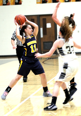 Photo by Chris Martin.  Shenandoah's Morgaen McWilliams makes a cross court pass Tueesday at Madison-Grant.