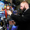 Don Knight | The Herald Bulletin<br /> Co-owner Daniel Hiles pours a beer during the grand opening for Kettle Top Brewhouse in downtown Anderson on Friday Dec. 9th.