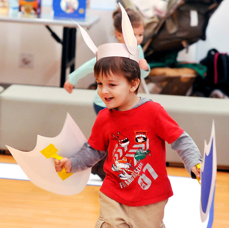 John P. Cleary |  The Herald Bulletin<br /> Simon Green, 3, with his helmet and shields, becomes a Super Hero as he plays during the Anderson Public Library's annual Toddler Tango/Preschool Promenade holiday special Tuesday. The event will be held again this Thursday morning from 10:30 a.m. to noon.