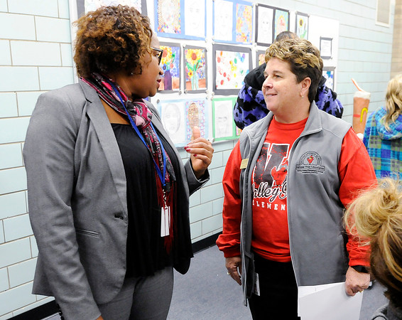 Don Knight | The Herald Bulletin<br /> Treva Bostic talks with Valley Grove principal Jan Koeniger before the Anderson Community Schools school board meeting on Tuesday.
