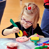 John P. Cleary |  The Herald Bulletin<br /> Kylie Scott, 4, gets into making her play dough cookie, with eyes, during the Anderson Public Library's annual Toddler Tango/Preschool Promenade holiday special Tuesday. The event will be held again this Thursday morning from 10:30 a.m. to noon featuring stories, songs, snacks and making festive keepsakes.