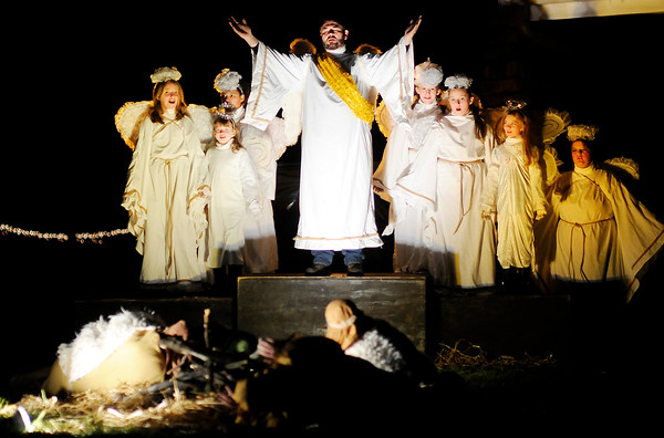 Don Knight | The Herald Bulletin<br /> Angles rejoice after telling a group of shepherds about the birth of Jesus during Maple Grove Church of God's Live Outdoor Nativity Pageant on Saturday. This is the 41st Anniversary of the pageant which was started by Layman Life Insurance in 1975 and given to the church in 1978. The soundtrack for the pageant was narrated by Dale Oldham. The pageant will perform again Sunday at 6, 6:30 and 7 p.m. Coffee, Hot Chocolate and Christmas cookies are served after each performance.