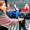 John P. Cleary |  The Herald Bulletin<br /> COMPASS program student Ja'Lyn Simms, left, plays with Oscaar as fellow students Drake Runyan, Brent Johnston and Brianna Decker watch and wait their turn to interact with the the program's new therapy dog.