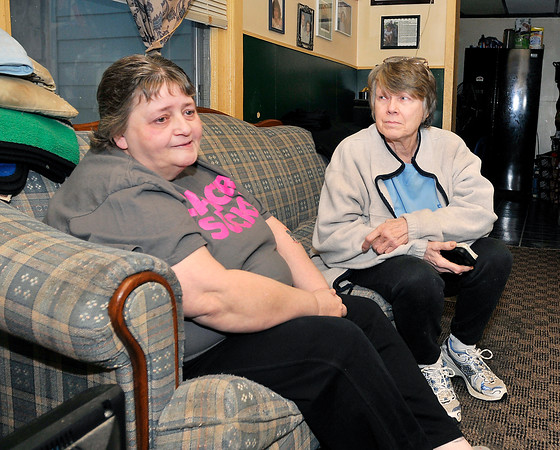 John P. Cleary |  The Herald Bulletin<br /> Animal lover Jan Ault, right, is working to find a home for Jesse, the cat of Jeffery Eckelbarger, 10, and his mother Danene Eckelbarger, left, who is fighting stage IV lung cancer.