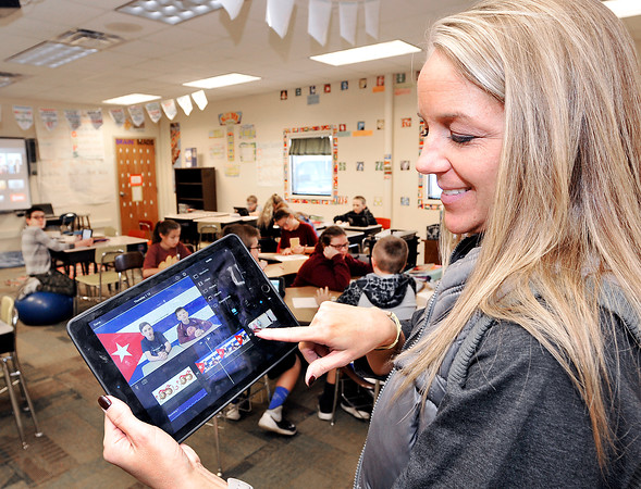 John P. Cleary    The Herald Bulletin<br /> Alexandria Intermediate School teacher Shannon Howell looks at one of the student-led school announcement videos her students have produced.  Howell has turned to the Donors Choose crowdfunding site for teachers to raise money to purchase video equipment for her students to use.
